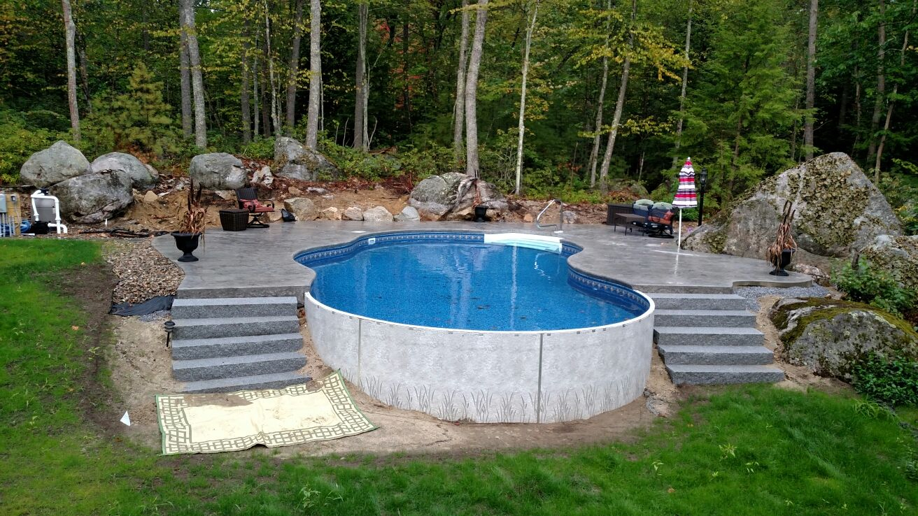 Radiant 18x32 Freeform Built Into A Hill With Stamped Concrete Deck in size 1312 X 738