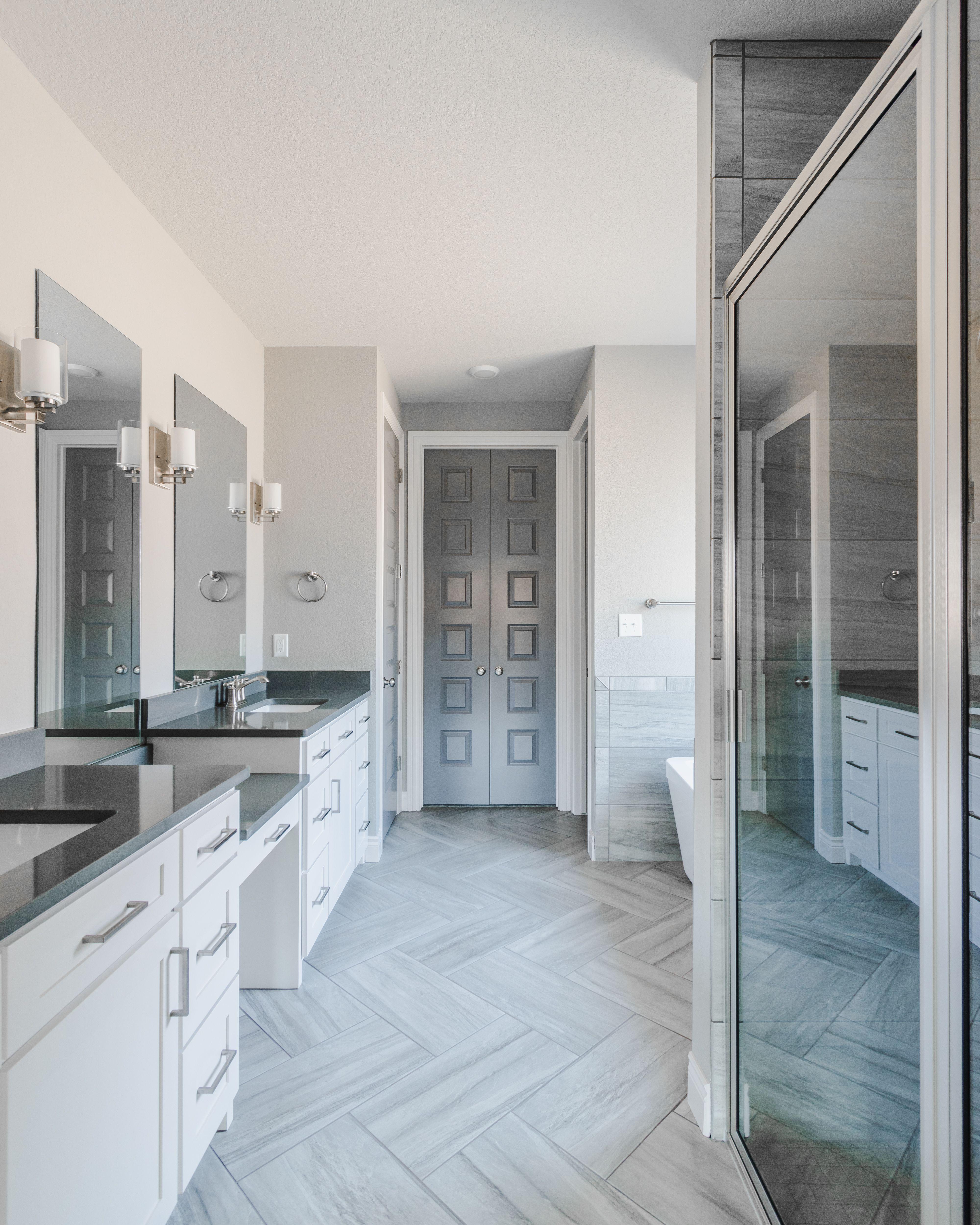 Gray Toned Master Bathroom Featuring Herringbone Tile Floor pertaining to dimensions 4000 X 5000